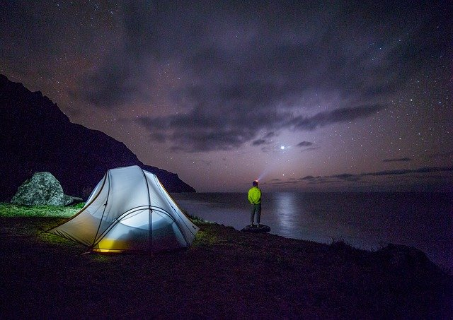 man staring at the stars